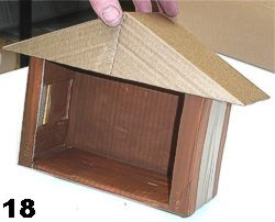 Put finished roof on main stable body. Now you can decorate and paint it to complete it.