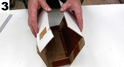 Once all the fold and cuts have been made, fold the cardboard together as shown