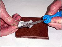 Use a metal file to remove any flash or remaining edges of metal.